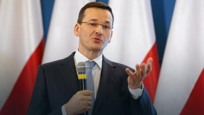 """Premier Morawiecki: Chcemy pomagać imigrantom """"w miejscu pochodzenia"""""""